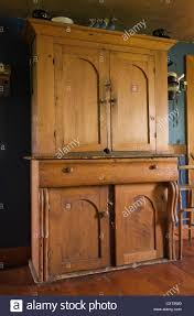 antique pinewood armoire in the dining room of an old canadiana