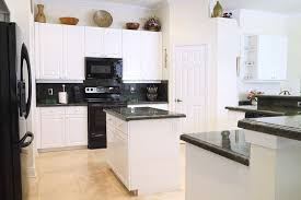 white kitchen cabinets with black appliances 36 beautiful white