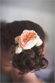 flower hair bun alyce prom 9 floral bridal hair ideas for your