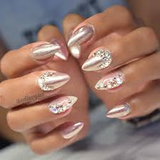 bedazzled chrome nails by celinaryden studs and 3d nail