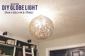 How To Make A Balloon Chandelier Diy Globe Light Made With A Balloon String And Paper Mache
