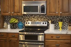 tiles backsplash gray countertop making raised panel cabinet