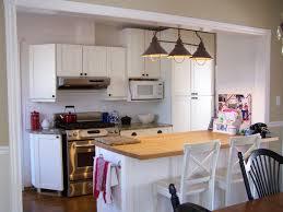 birch wood cherry raised door lights over kitchen island