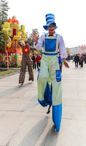 clown stilts clown walking on stilt in a park chengdu china editorial image