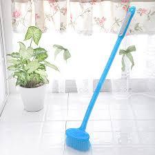 bathtub bathroom floor tile floor brush handled skillet
