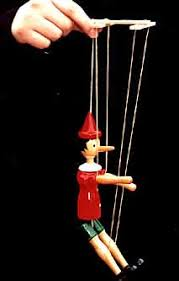 string puppet puppets who s pulling the strings
