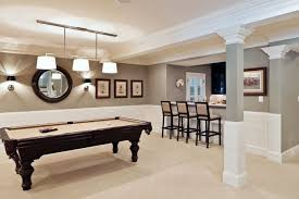basement with pool table and wall sconces basement walls pool