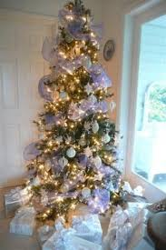 white tree with silver decorations home design and