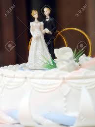 and groom figurines closeup of marzipan wedding cake with and groom figurines