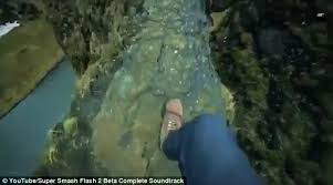 narrow picture ledge terrifying footage shows hiker climb to outcrop in iceland daily