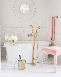 Lucite Bathtub White And Pink Bathroom Features A Lucite Sunburst Mirror Place