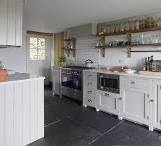 stylish kitchen farmhouse with white metro tile traditional wall