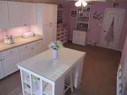 Pink Craft Room - craft room with white cabinets work island and pink walls