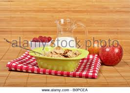 pcea cuisine a bowl of cornflakes two apples and raspberries on bamboo mat