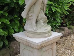 garden cast venus goddess statue on plinth