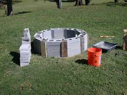 round cinder blocks beginning of fire pit outside landscape
