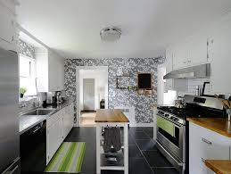 kitchens with shelves green blue floral wallpaper white cabinets floating shelves green island