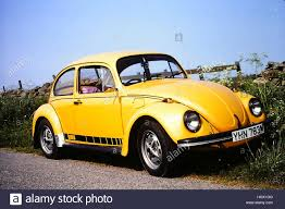 volkswagen yellow car vehicle retro yellow volkswagen beetle stock photo royalty free image