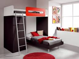 white concrete wall black wooden child level bed with storage white bedding grey