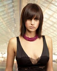 Medium Length Shag Hairstyles by Shoulder Length Shag With A Textured Fringe That Almost Hides