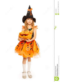 in witch dress hold carved halloween pumpkin stock photo