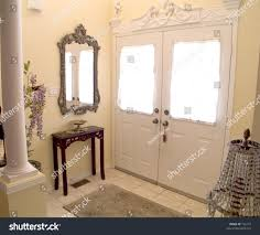 ornate entry hall white windowed doors stock photo 155777