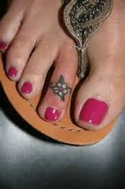 flower tattoo ring toe tattoo google search tattoos pinterest toe tattoos