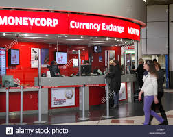 currency exchange bureau at gatwick airport stock photo 68440681