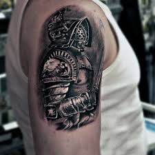 real photo like black ink detailed shoulder tattoo of medieval