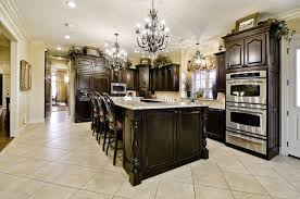 kitchen island with granite top and breakfast bar creative kitchen island chandelier lighting above giallo