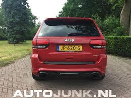 ferrari jeep jeep grand cherokee srt 8 in ferrari rood foto u0027s autojunk nl