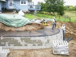 Sloping Backyard Ideas A Modular Block Retaining Wall Reshapes Sloping Backyard Also Back