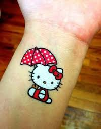 a hello kitty tattoo with a piercing to for the eyes tattoos
