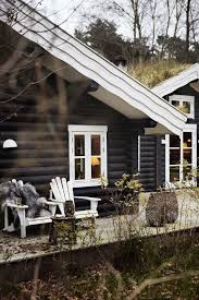 black stained log cabin with great deck design and details