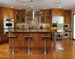 small kitchen island set in the middle part surronding kitchen set