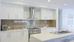 kitchen room grey ceramic backsplash chrome kettle dishware