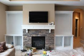 tv mounted above fireplace where to put cable box hid my cable