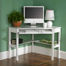 white wooden floating computer desk and floating wooden cabinet on