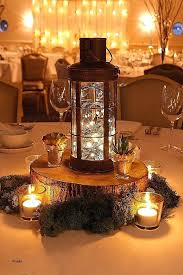 candelabra centerpiece centerpiece candle tree stump centerpiece via candelabra