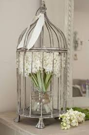 bird cage decoration i moss especially for weddings and wish i would used