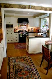 vintage cabinets kitchen furniture kitchen with tile flooring and chiasso rug also wooden