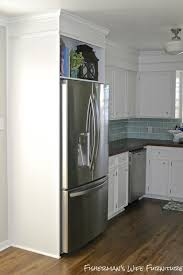 Small White Kitchen Makeover With Built In Fridge Enclosure