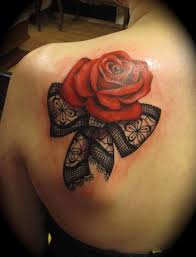tattoo on shoulder blade and grey shaded roses flower tattoo