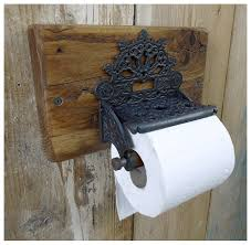 a superb decorative cast iron toilet roll holder and lid by hooks
