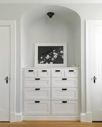 wonderful built in dresser with mirror and sconces and tall