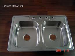 kitchen sink with faucet choosing a faucet cover for your kitchen sink stainless