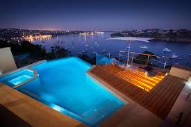 evening pool lighting water views stunning riverside home in