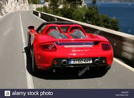 porsche carrera red car porsche carrera gt model year 2005 red convertible open