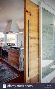 Sliding Door Design For Kitchen View Into Kitchen Through Wooden Sliding Door In Modern Apartment