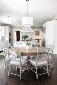 round gray wood dining table with gray bamboo dining chairs and